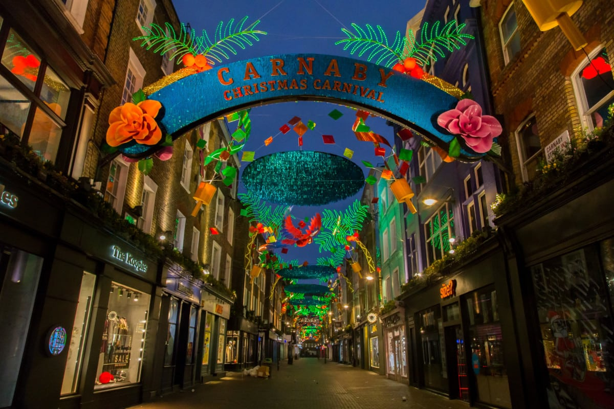 colourful Carnaby Street at night with shops