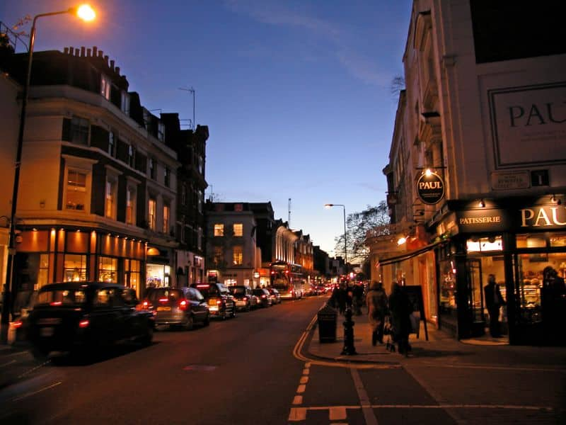 King's Road at night with cars and people