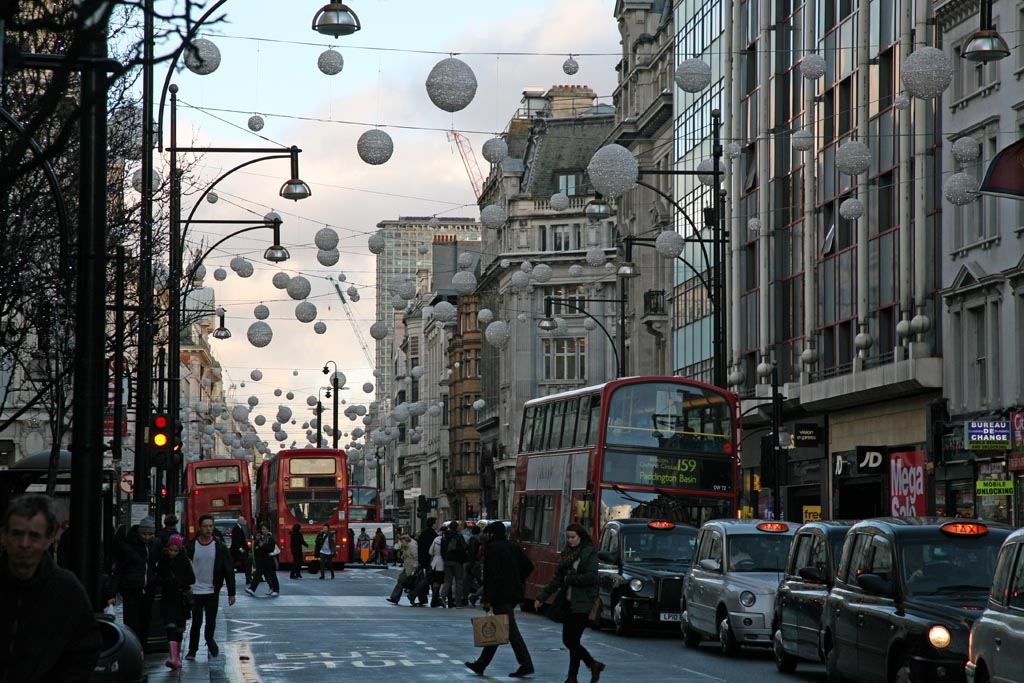 """""""crowded Oxford Street with traffic during day"""