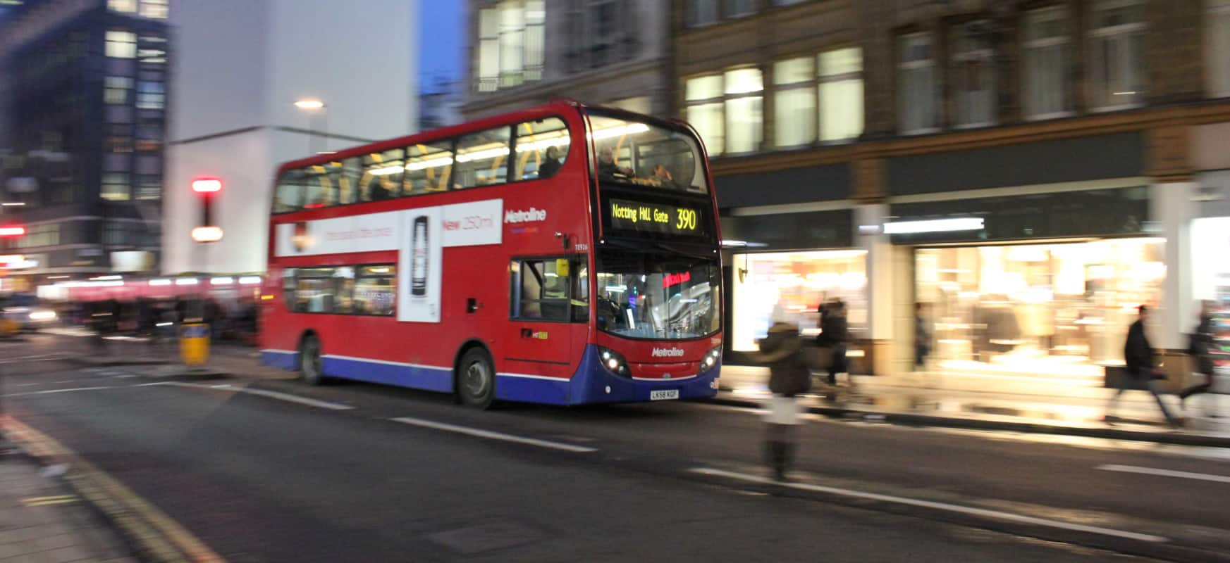 The night bus of London passing the street