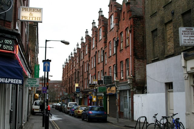 """""""Hanbury Street with cars and bikes in East London"""""""