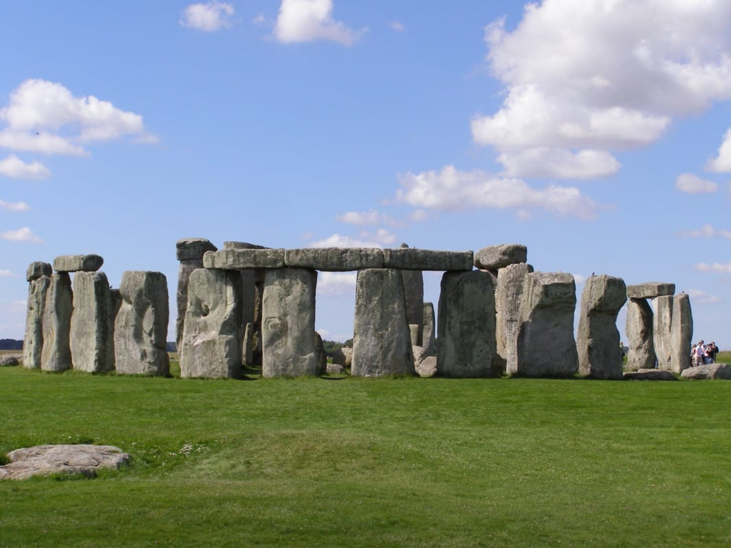 """""""Stonehenge with blue sky and green land in England"""""""