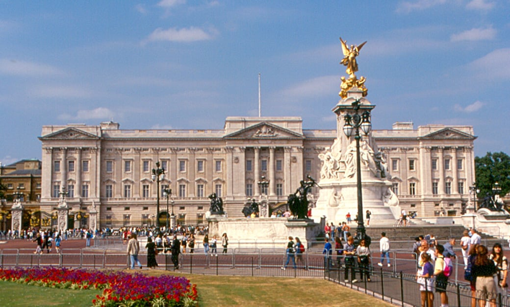 """""""The Buckingham Palace seen from outside with crowd on a sunny day"""""""